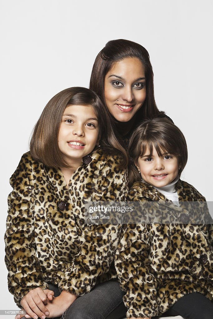 Mother with two daughters, smiling, portrait : Stock Photo