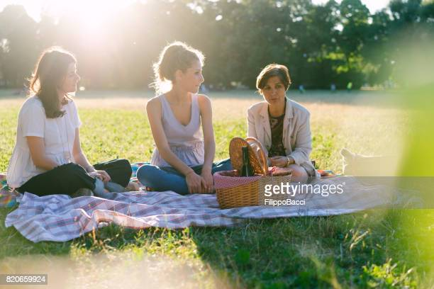 Mother with young adult daughters on picnic