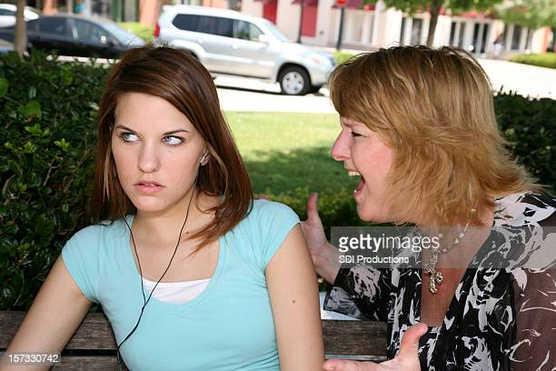 Mother yelling at her daughter in a park
