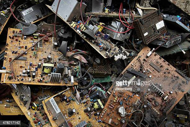Motherboards and other used computer components sit in a pile at a workshop in New Delhi India on Thursday June 18 2015 The rupee climbed 08 percent...