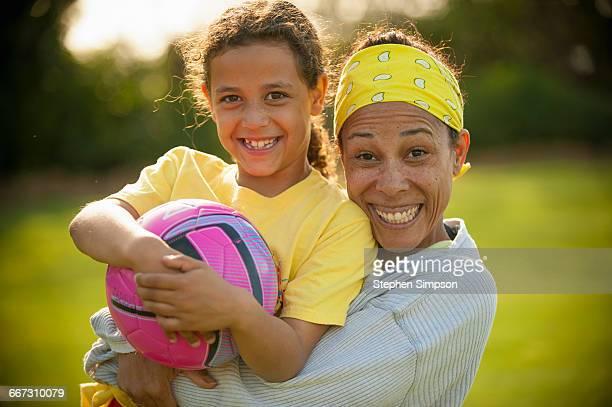 mother/daughter portrait at soccer practice