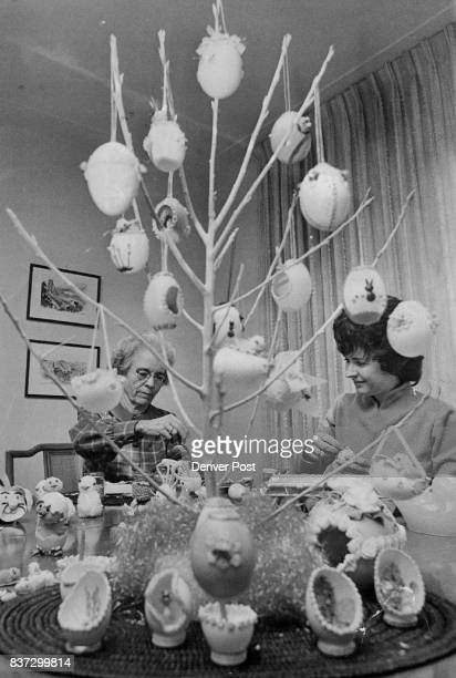 Motherdaughter team of Mrs N II Henley left and Mrs A E Hawkins use bread dough and tiny seashells to decorate 40 dozen eggs Credit Denver Post Inc
