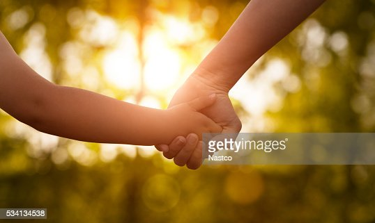 Mother's and a child hands : Stock Photo