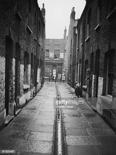 Mothers and children in a slum area of Stepney in the East End of London 9th March 1946 London County Council is planning to transform the area as...