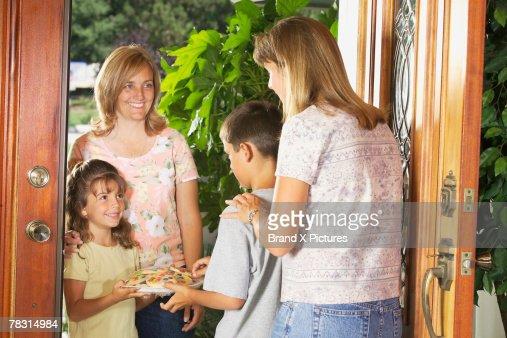 Mothers and children in doorway