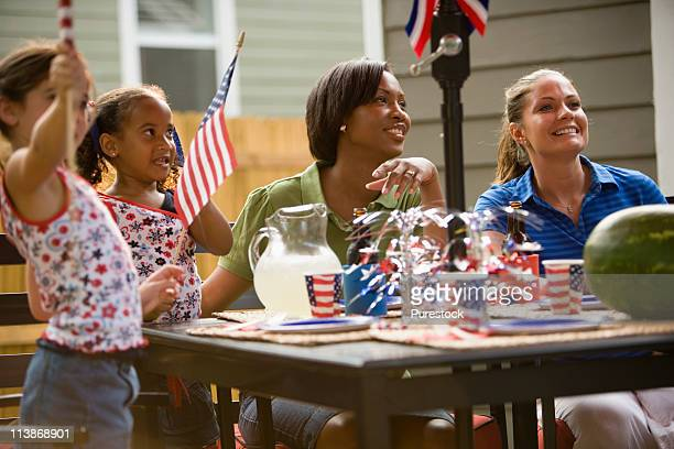 Mothers and daughters celebrating 4th of July