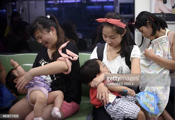Mothers breastfeed their babies in a subway during an event of the world breastfeeding week on August 1 2015 Around 20 mothers breastfed their babies...