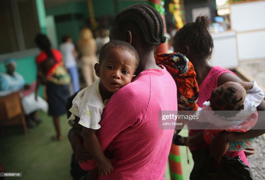 Mothers bring their sick children for treatment at Redemption Hospital formerly an Ebola holding center on February 2 2015 in Monrovia Liberia Life...