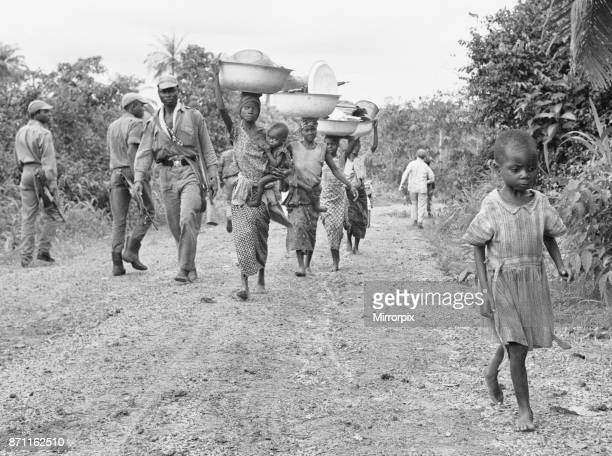 Mothers carrying their babies and all their possessions flee the front line in search of food 5th July 1968