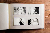 Mothers day composition. Photo album, black-and-white pictures. Studio shot on wooden background.