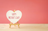 mother's day concept image. Board by heart shape.