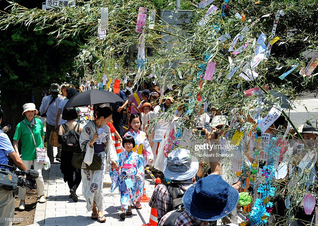 Mothers demanding 'the Life without Nuclear Plant and exposure' protest in front of the Prime Minister's official residence on July 7, 2013 in Tokyo, Japan. The participants write the messages on to paper strips and hung to bamboos during the protest on Tanabata Star Festival.