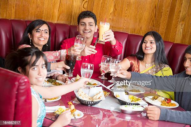 Mothers enjoying dinner with their children at indian restaurant