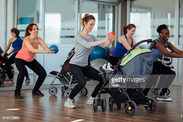 Mothers Exercising with Their Babies in a Gym