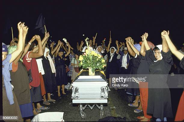 Mothers of Disappeared raising linked hands around the coffin of assassinated Human Rights Comm president Herbert Anaya Sanabria