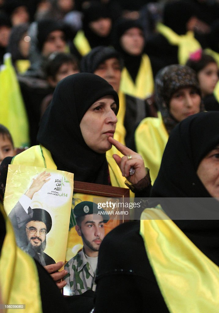 Mothers of killed Hezbollah fighters attend a ceremony organized by the militant Shiite Muslim group Hezbollah on the occasion of Martyr's Day in the southern suburbs of Beirut November 12, 2012.