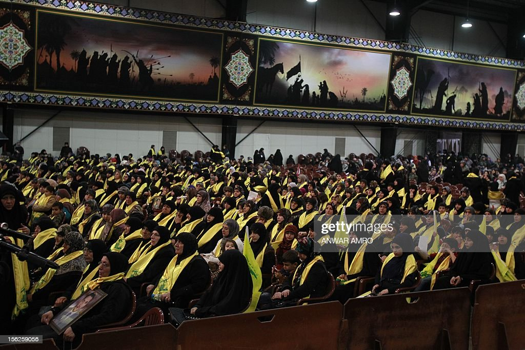 Mothers of killed Hezbollah fighters watch Hezbollah chief Hassan Nasrallah speak during a televised address to a rally marking the party's Martyrs' Day in southern Beirut, on November 12, 2012.