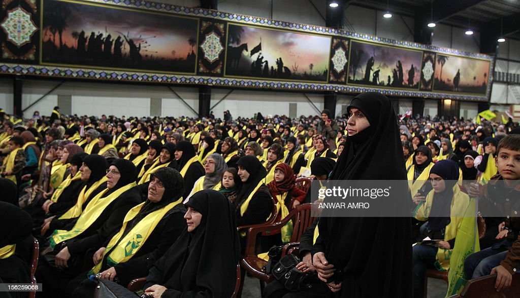 Mothers of killed Hezbollah fighters watch Hezbollah chief Hassan Nasrallah speak during a televised address to a rally marking the party's Martyrs' Day in southern Beirut, on November 12, 2012. AFP PHOTO/ANWAR AMRO