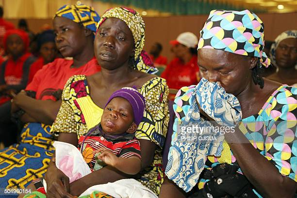 Mothers of missing girls kidnapped in 2014 from their school in Chibok react during a rally in Abuja on January 14 2016 Parents of the some 200 girls...