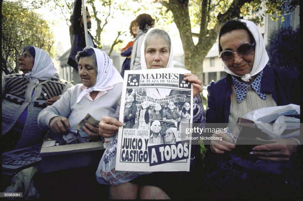 Mothers of Plaza de Mayo at demonstration regarding missing persons who disappeared during military regime with pictures of their relatives signs etc...