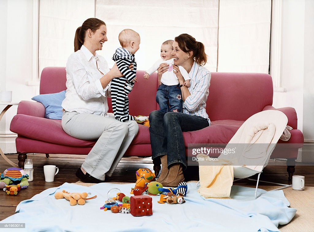 Mothers Playing with Their Children in a Living Room