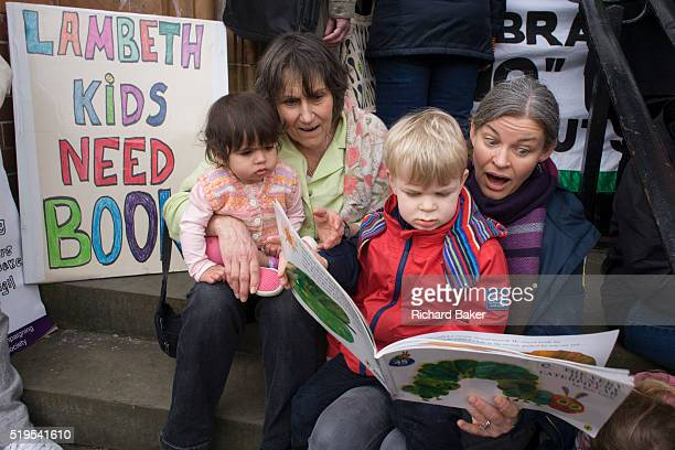 Mothers read to their children while protesting on the steps of Carnegie Library in Herne Hill south London while occupiers remain inside the...
