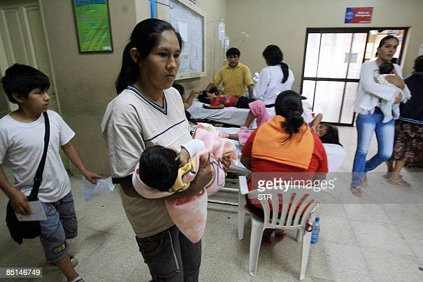 Mothers with their children presumably affected by dengue await to be seen by doctors at hospital in Santa Cruz eastern Bolivia on February 27 2009...