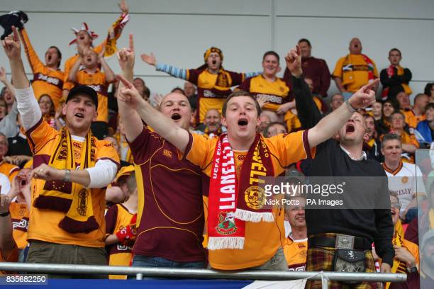 Motherwell fans celebrates after Jamie Murphy scored the third goal against Llanelli during the Europa League Qualifying Second Leg at Parc y...