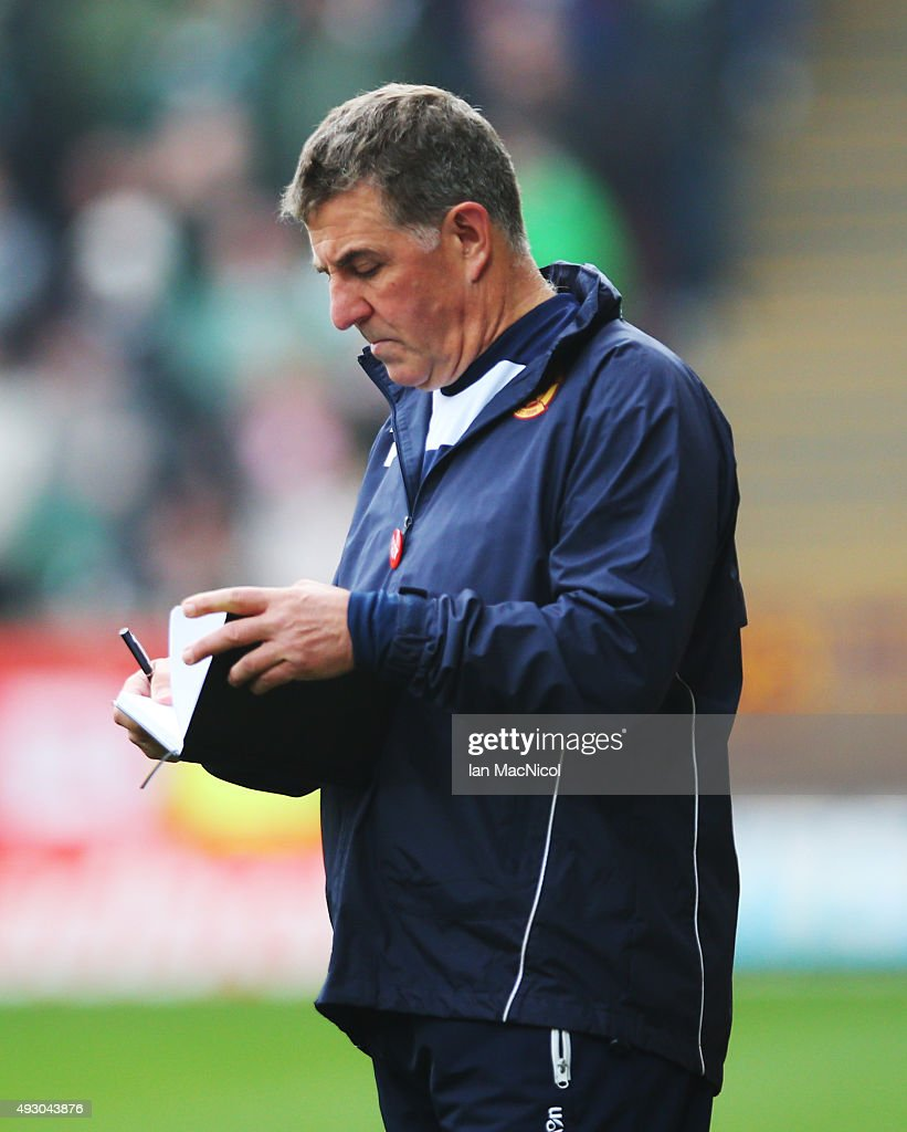 Motherwell manager Mark McGhee takes notes during the Ladbrokes Scottish Premiership match between Motherwell and Celtic at Fir Park on October 17...