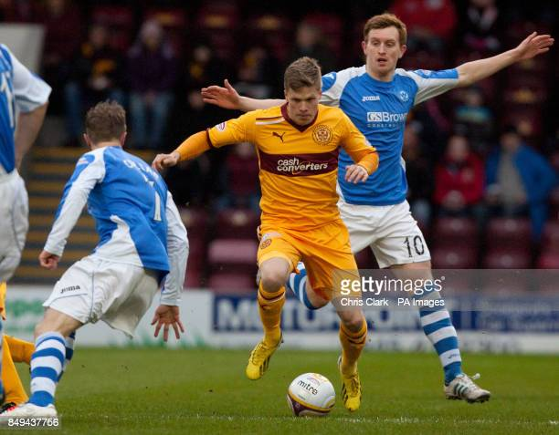 Motherwell's Henrik Ojamaa breaks through the tackle from St Johnstone's Liam Craig during the Clydesdale Bank Scottish Premier League match at Fir...