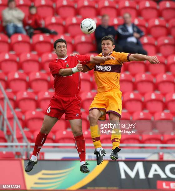 Motherwell's John Sutton challenges Llanelli defender Wyn Thomas or the ball during the Europa League Qualifying Second Leg at Parc y Scarlets...