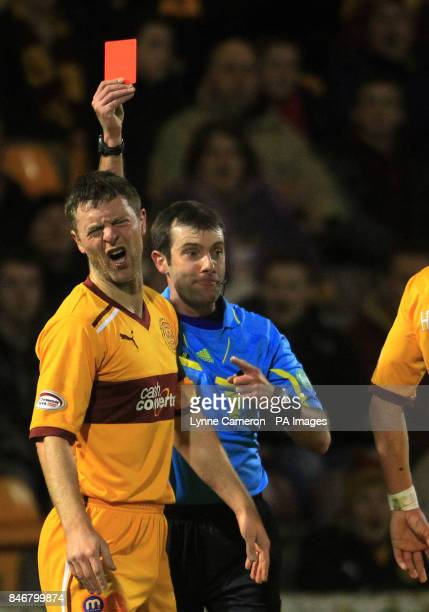 Motherwell's Stephen Craigan is sent off by Referee Alan Muir following an incident with Dunfermline's Andrew Barrowman during the Clydesdale Bank...