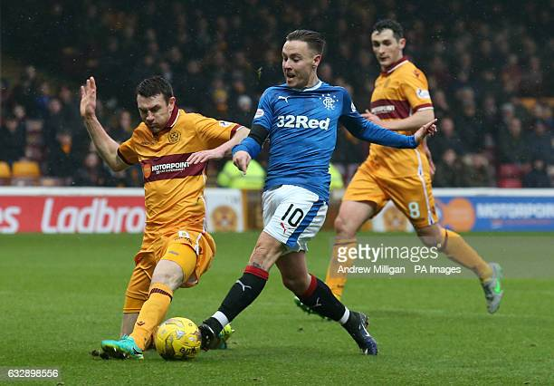 Motherwell's Stephen McManus and Rangers' Barrie McKay battle for the ball during the Ladbrokes Scottish Premiership match at Fir Par Motherwell