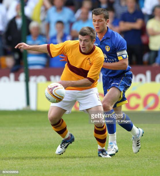 Motherwell's Steve Jennings and Leeds United's Jonathon Howson during the Pre Season Friendly at Fir Park Motherwell