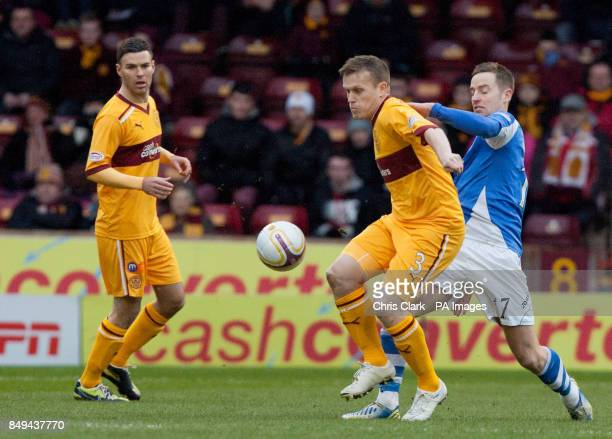 Motherwell's Steven Hammell shields the ball from St Johnstone's Steven MacLean during the Clydesdale Bank Scottish Premier League match at Fir Park...