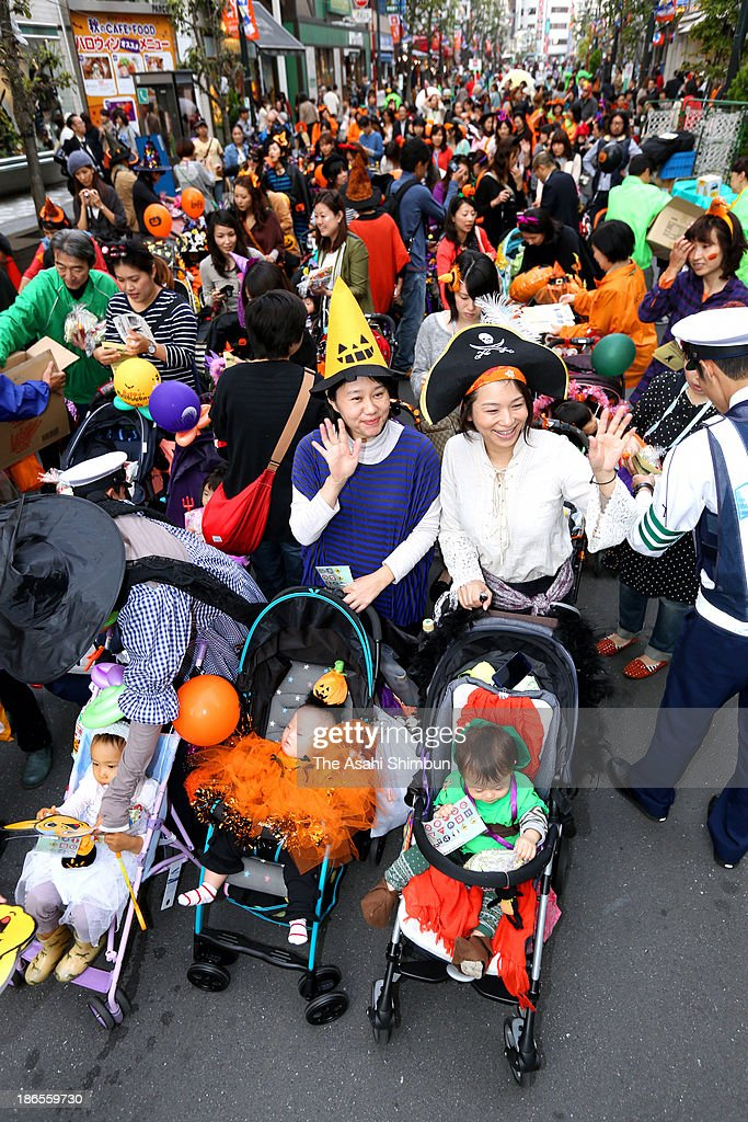 Mothes with baby strollers participate in halloween costume parade held near Kichijoji station on October 30, 2013 in Musashino, Tokyo, Japan. The purpose of this event is to create an opportunity for parents to go out and have fun as they sometimes have difficult time going out with toddlers, the organizer, a group of mothers, 'Precious Net' says.