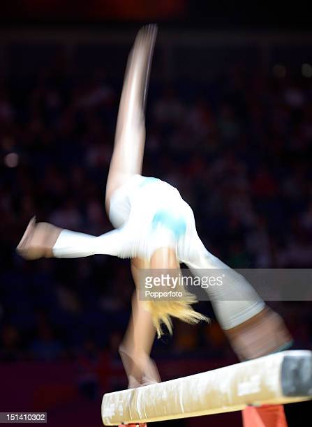 Motion blur action of a competitor on the beam during the Artistic Gymnastics Women's Beam final on Day 11 of the London 2012 Olympic Games at North...