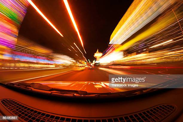 Motion blur of car driving down street