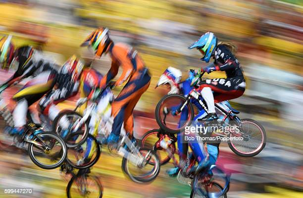 Motion blur of competitors during the Women's BMX Semi Finals on day 14 of the Rio 2016 Olympic Games at the Olympic BMX Centre on August 19 2016 in...