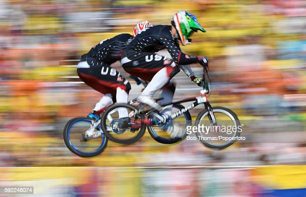 Motion blur of Connor Fields and Nicholas Long of the United States during the Mens BMX Final on day 14 of the Rio 2016 Olympic Games at the Olympic...