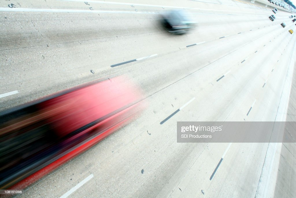 Motion Blur of Fast Cars on Highway