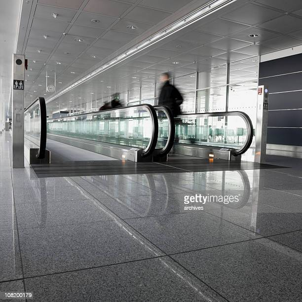 Motion Blur of People Walking on Moving Sidewalk at Airport