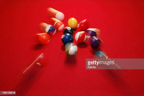 Motion Blur of Pool Balls Scattering on Red Table