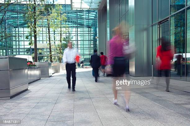 Motion blur photo of people in financial district