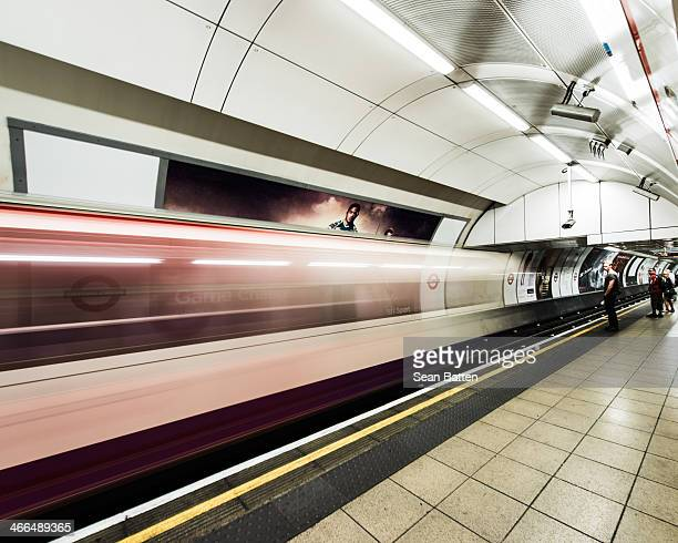CONTENT] A motion blur shot of a tube train at Oxford Circus underground station