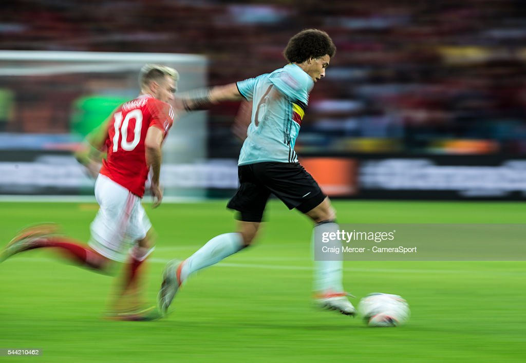 A motion blur shot of Belgium's <a gi-track='captionPersonalityLinkClicked' href=/galleries/search?phrase=Axel+Witsel&family=editorial&specificpeople=4345455 ng-click='$event.stopPropagation()'>Axel Witsel</a> holding off the challenge from Wales's <a gi-track='captionPersonalityLinkClicked' href=/galleries/search?phrase=Aaron+Ramsey+-+Soccer+Player&family=editorial&specificpeople=4784114 ng-click='$event.stopPropagation()'>Aaron Ramsey</a> during the UEFA Euro 2016 Quarter-final match between Wales and Belgium at Stade Pierre Mauroy on July 01 in Marseille, France.
