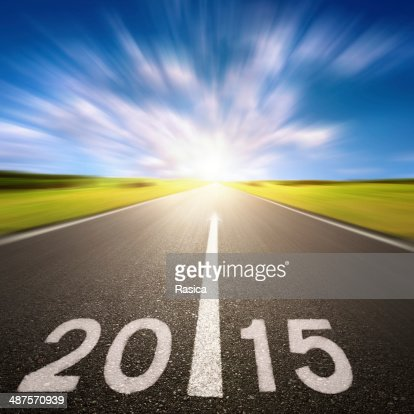 Motion blurred asphalt road forward to 2015 : Stock Photo