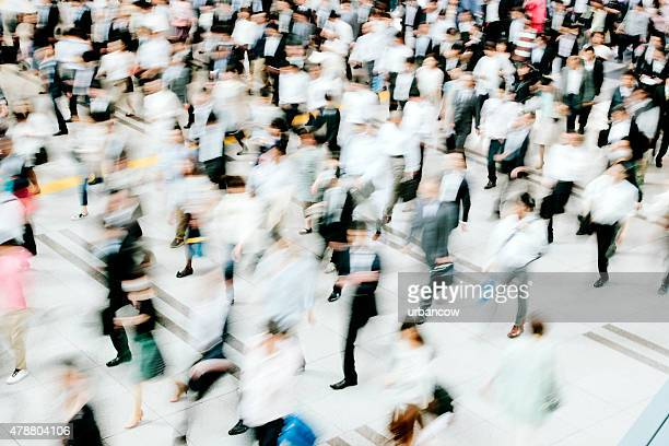 Motion blurred crowded pedestrian walkway, business people, Tokyo