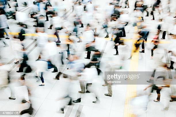 Motion blurred crowded pedestrian walkway, business people, Tokyo
