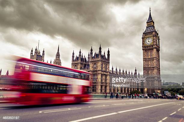 Motion blurred image of double decker bus driving to Big Ben